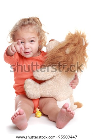 adorable little curly blond girl hugging toy