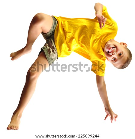 Adorable little elementary boy dancing, exercising and jumping. Isolated over white background - stock photo