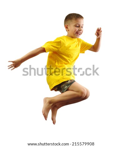 adorable little elementary boy exercising and jumping - stock photo