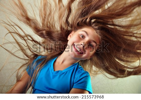 adorable little elementary girl exercising with a hoop - stock photo
