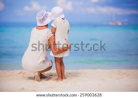Adorable little girl and happy mother on summer vacation - stock photo