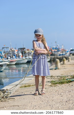 Adorable little girl at fisherman village - stock photo