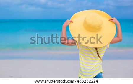 Adorable little girl at the beach - stock photo