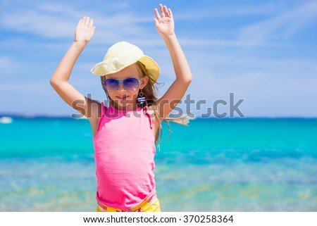Adorable little girl at the beach vacation - stock photo