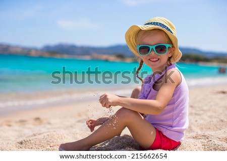 Adorable little girl at tropical beach during European vacation