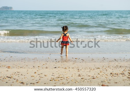 Adorable little girl at tropical white sand beach - stock photo