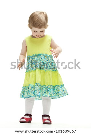 Adorable little girl dancing; full length on white background