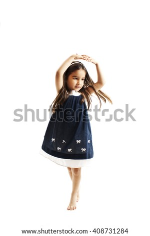 Adorable little girl dancing isolated on white background - stock photo
