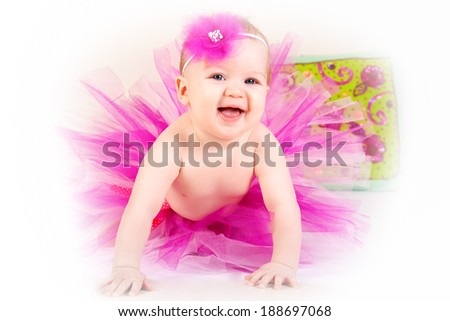 Adorable little girl dressed as a ballerina in a tutu, crown of roses - stock photo