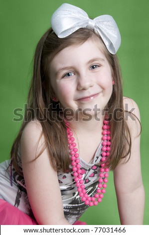 Adorable little girl dressed up in 80's clothes
