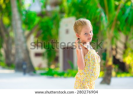 Adorable little girl during beach summer vacation  - stock photo
