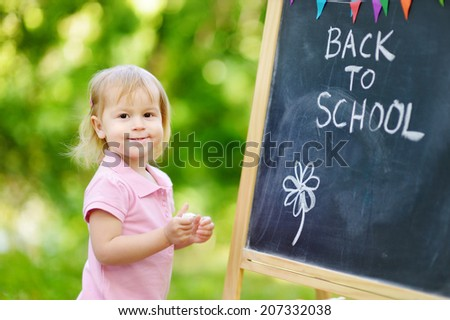 Adorable little girl feeling excited about going to preschool for the first time - stock photo