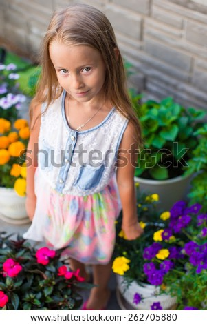 Adorable little girl happy outdoor at summer time - stock photo