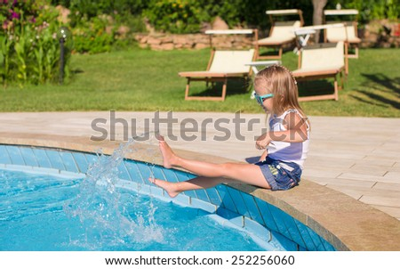 Adorable little girl have fun outdoors - stock photo