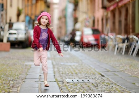 Adorable little girl having fun outdoors - stock photo