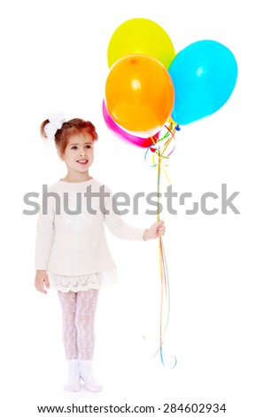 Adorable little girl holding a bunch of balloons- isolated on white background - stock photo