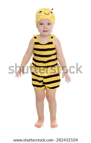 Adorable little girl in a striped bee costume- isolated on white background - stock photo