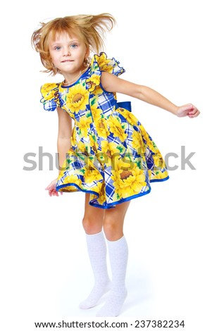 Adorable little girl in a yellow dress.Isolated on white background. - stock photo