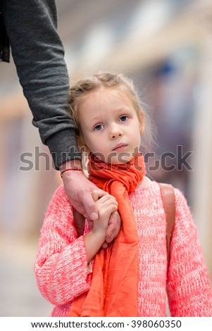 Adorable little girl in airport waiting for boarding - stock photo