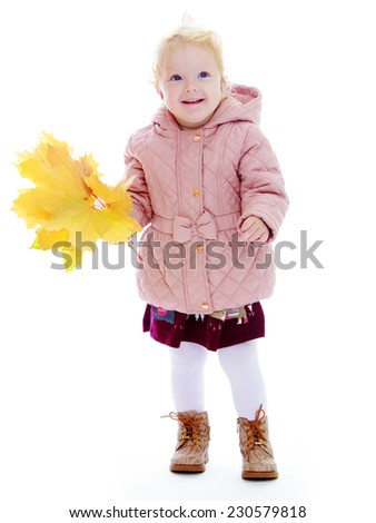 Adorable little girl in autumn coat holding a maple leaf. - stock photo