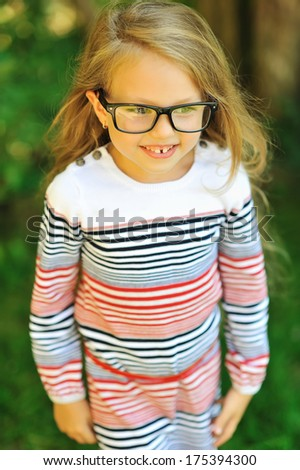 Adorable little girl in glases - outdoors  - stock photo