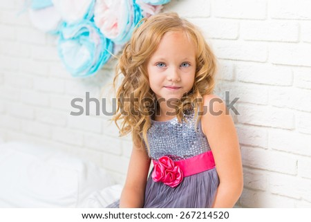 Adorable little girl in her room - stock photo