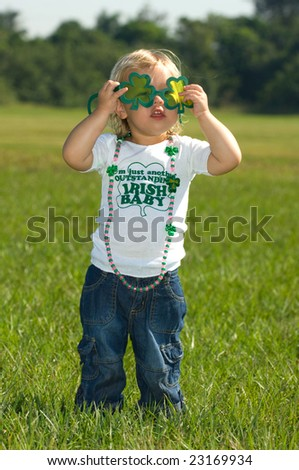 Adorable little girl in jeans and Irish t shirt - stock photo