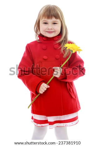 Adorable little girl in red coat with yellow flower in her hand.Happy childhood, fashion, autumnal mood concept. Isolated on white background - stock photo