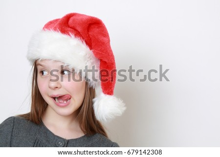 Adorable little girl in santa hat
