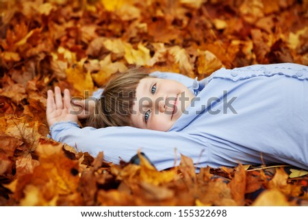 adorable little girl in the beauty park - stock photo