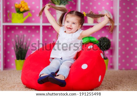 Adorable little girl in the nursery. emotions,  smile - stock photo