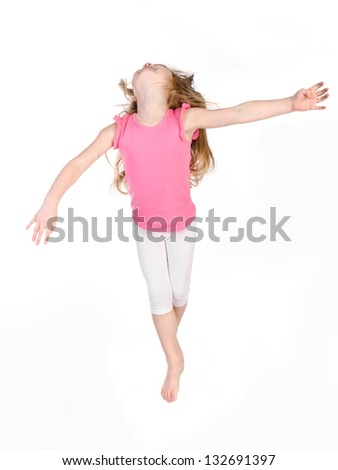 Adorable little girl jumping in air isolated over white background
