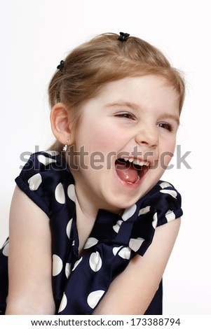 Adorable little girl laughing  - stock photo