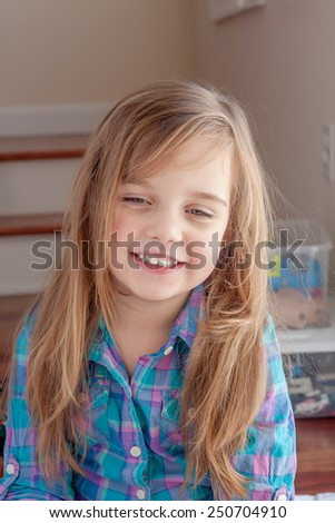 adorable little girl laughing at her mother - stock photo