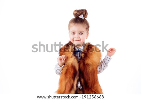 Adorable little girl on a white background. fashion portrait.   - stock photo