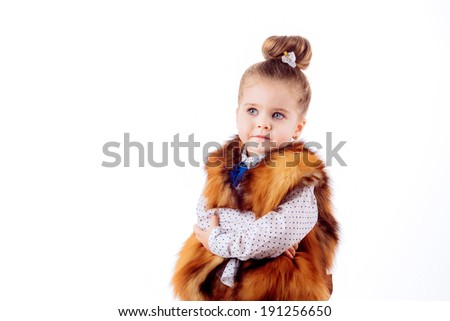 Adorable little girl on a white background. fashion portrait. isolated on white background - stock photo