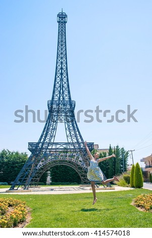 Adorable little girl on background the Eiffel tower during summer vacation. replica of the Eiffel Tower