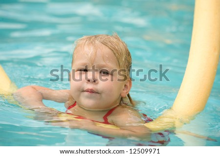 Adorable Little Girl on Raft in Swimming Pool - stock photo