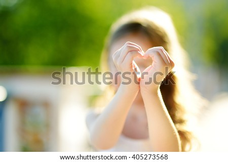 Adorable little girl on warm and sunny summer day - stock photo