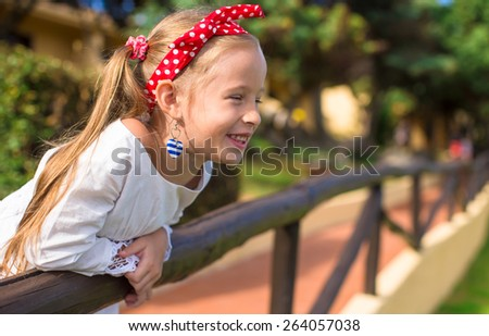 Adorable little girl outdoors during summer vacation - stock photo