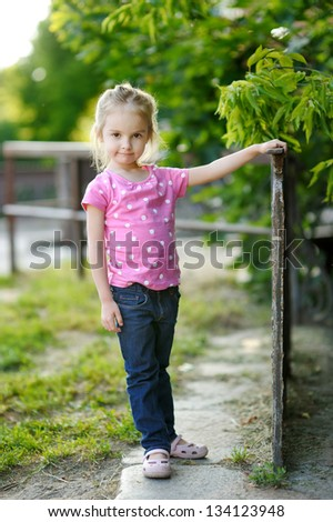 Adorable little girl portrait outdoors - stock photo