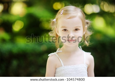Adorable little girl portrait outdoors at summer - stock photo