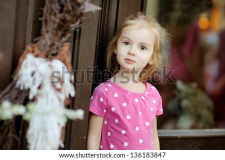 Adorable little girl portrait outdoors at summer