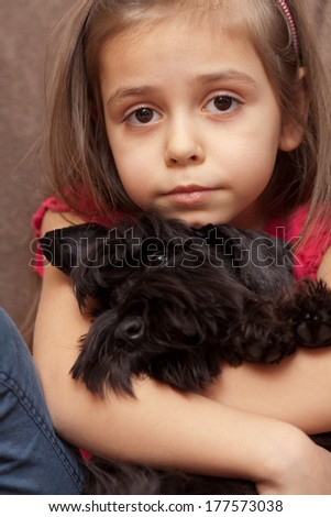 Adorable little girl poses with her miniature schnauzer - stock photo