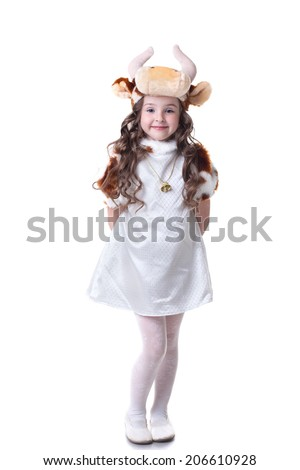 Adorable little girl posing in cow costume - stock photo