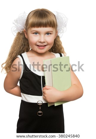 Adorable little girl schoolgirl presses a hand to his chest a thick book . Closeup - Isolated on white background