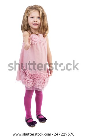 Adorable little girl showing thumb up against white background - stock photo