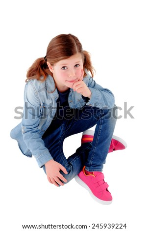 Adorable little girl sitting on the floor with denim shirt isolated on a white background - stock photo