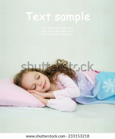 Adorable little girl sleeping in her bed.  Nighty night! good night! Room for text. - stock photo
