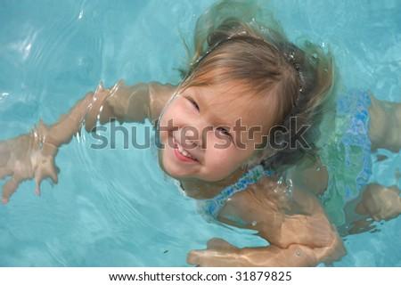 Adorable Little Girl Swimming - stock photo